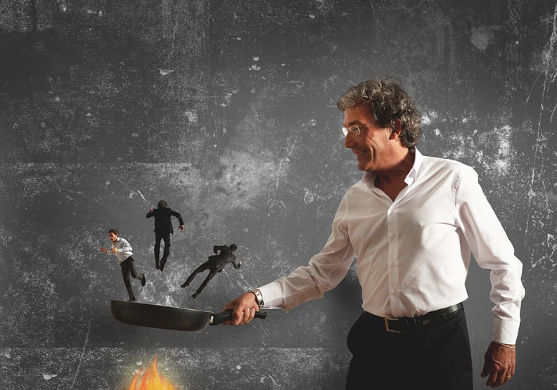 Concept of business man that burns in the pan the competitor